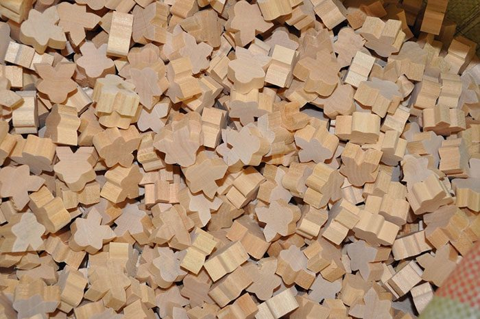 Unfinished wooden meeples