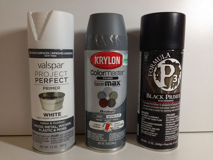 various cans of primer paint