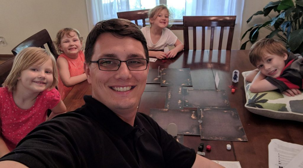 A family sitting around a table.