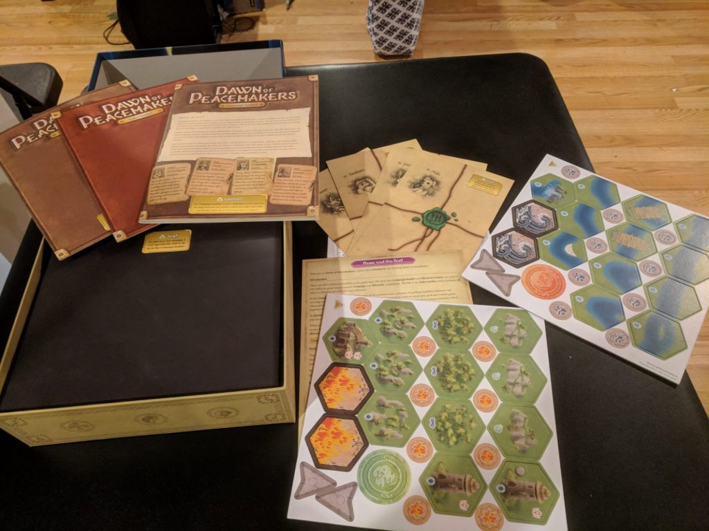 Photo of rule books spread on first open of box.