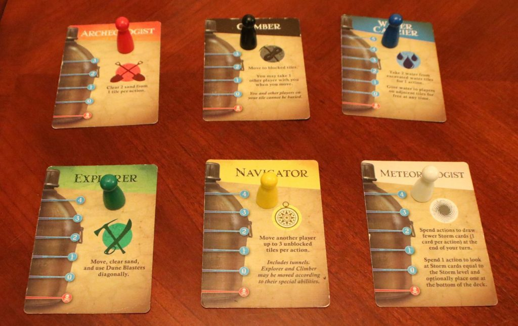 A picture of the character cards and pawns, lined up for easy display.