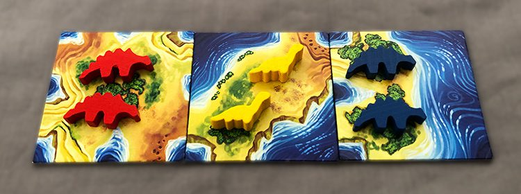 A three player game fully started with two DinoMeeples on each tile.