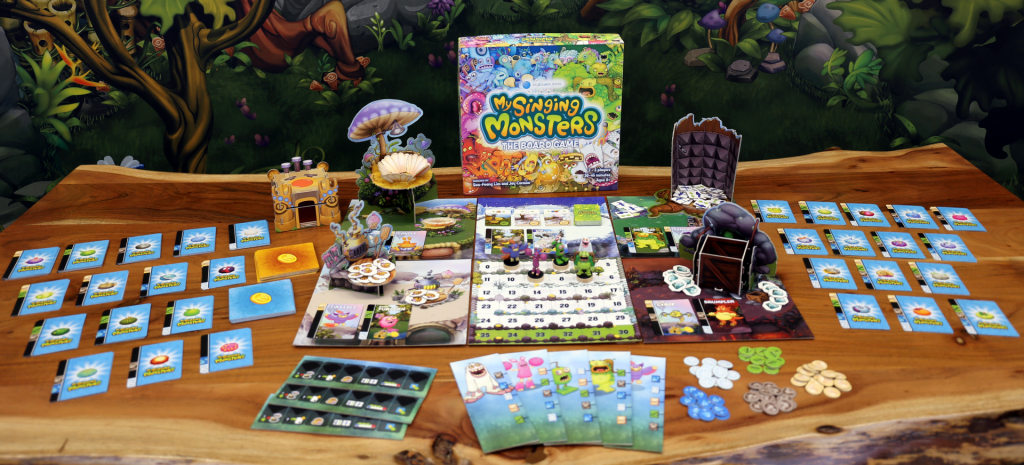 The contents of the My Singing Monsters Kickstarter game.